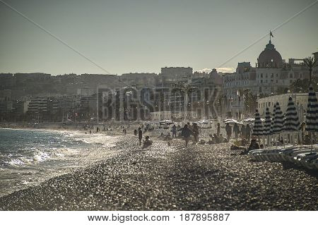 Seaside resort on Nice beach in France during summer time. A breathtaking landscape.