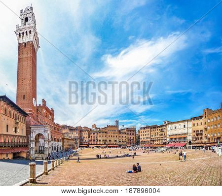 Famous Piazza Del Campo With Torre Del Mangia In Siena, Tuscany, Italy