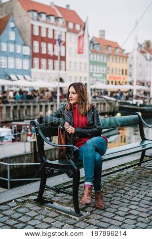 Woman sitting on a bench in Copenhagen