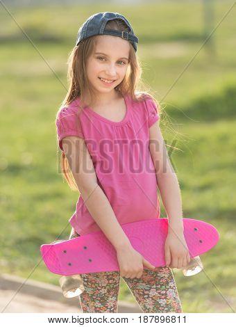 teenage girl holding her pink board