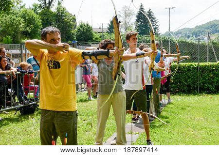 People Who Are Learning To Archery At Massagno On Switzerland