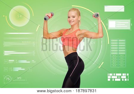sport, fitness and people concept - happy smiling young sporty woman exercising with light dumbbells over green background