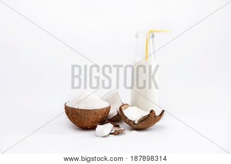 Ripe Organic Coconut With Shavings And Coconut Milk In Glass Bottle Isolated On White, Coconut Drink