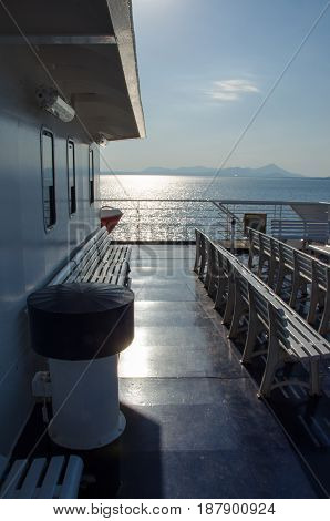 ferry boat deck with rows of plastic seats