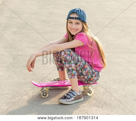 girl with long hair sitting on skating board