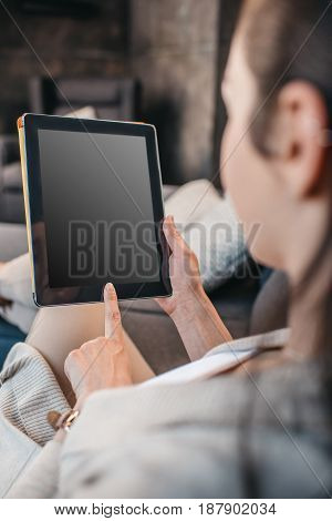 Cropped Shot Of Woman Pointing On Blank Screen Of Digital Tablet