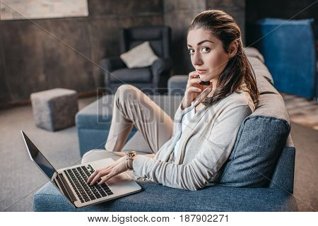 Young Woman Having Conversation On Smartphone During Work On Laptop At Home, Home Business Concept