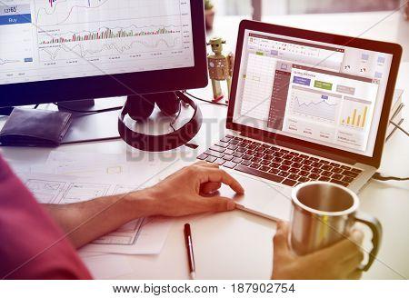 A Man Working Plan Graph Bar Chart On A White Table