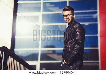 Stylish man in a leather jacket in an urban environment