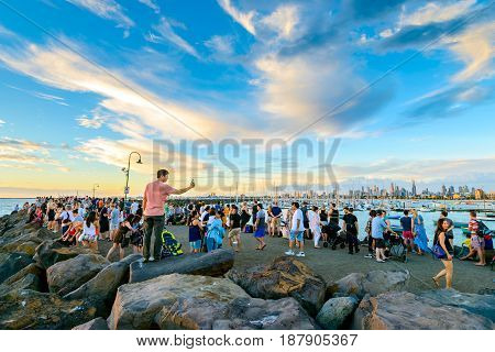 Melbourne Australia - December 28 2016: Crowd of people gathered at St Kilda breakwater to watch penguins after sunset on a warm summer evening