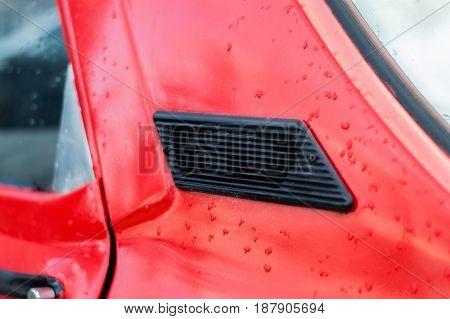 Closeup Detail Of Red Retro Classic Car