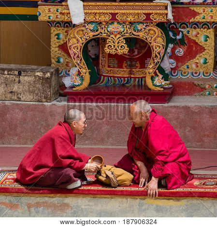LAMAYURU INDIA - JUNE 13 2015: Unidentified two buddhist monk during mystical mask dancing Tsam mystery dance in time of Yuru Kabgyat Buddhist festival at Lamayuru Gompa Ladakh North India