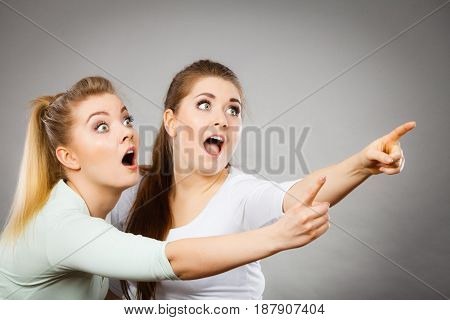 Happy Women Pointing Up With One Finger.