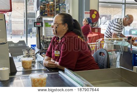 Cashier Woman Sitting On His Work Place At Israeli Food Supermarket