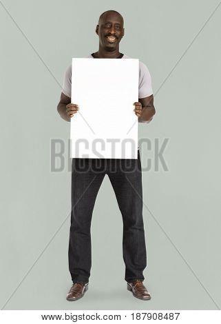 African descent man holding placard