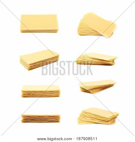 Pile of dried lasagna pasta sheets isolated over the white background, set of eight different foreshortenings