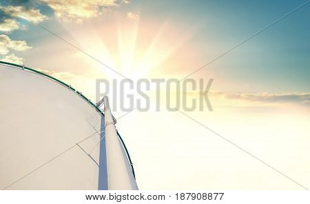 A large oil reservoir against a beautiful sunset or sunrise. Background for your design