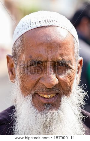 PUSHKAR INDIA - OCTOBER 28 2014: Unidentified Indian muslim man attended the annual Pushkar Camel Mela. This fair is the largest camel trading fair in the world.