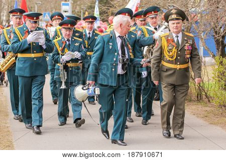 Kirishi, Russia - 9 May, A group of military musicians walking along the path, 9 May, 2017. Holding a festive rally dedicated to the Victory Day.