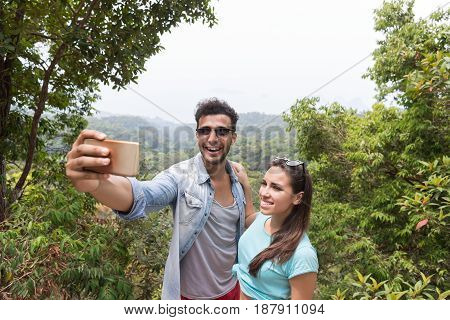 Young Couple Taking Selfie Photo On Cell Smart Phone Over Beautiful Landscape, Man And Woman Happy Smiling Tourists On Hike