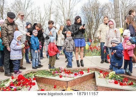 Kirishi, Russia - 9 May, People with children on the day of the memory of the fallen, 9 May, 2017. Laying wreaths and flowers in memory of the fallen at the Eternal Flame.