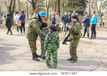Kirishi, Russia - 9 May, Adults and children in uniform, 9 May, 2017. Festive events in the city park on the occasion of Victory Day.