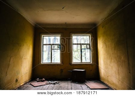 Room with two windows in abandoned ruined house, abandoned building inside interior