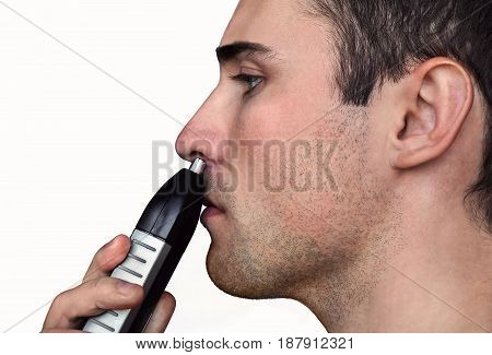 Close Up Man Portrait With Trimmer Near His Nose