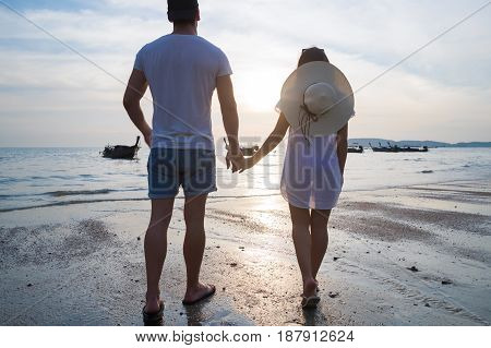 Couple Beach Summer Vacation, Man Woman Holding Hands Sunset Young Guy Girl Back Rear View Sea Ocean Holiday Travel