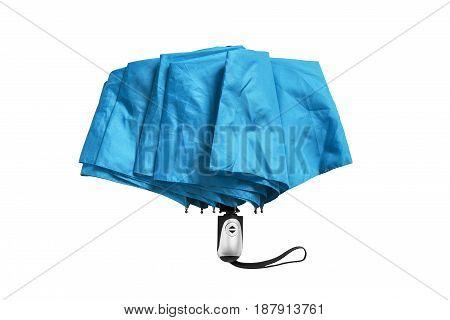 Blue folded automatic umbrella isolated over white