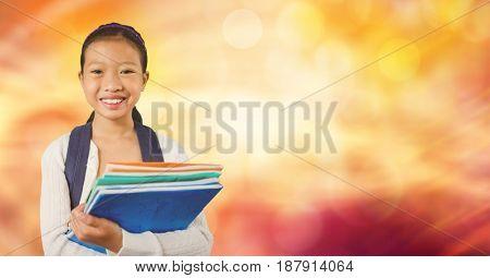 Digital composite of Happy school girl holding books