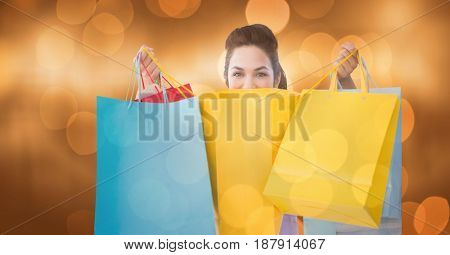 Digital composite of Portrait of woman with shopping bags over bokeh