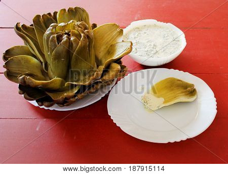 Artichoke cooked with leaves and for sauce