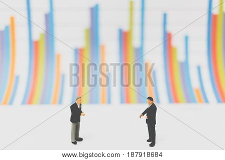 Miniature People Businessman Standing On  Chart