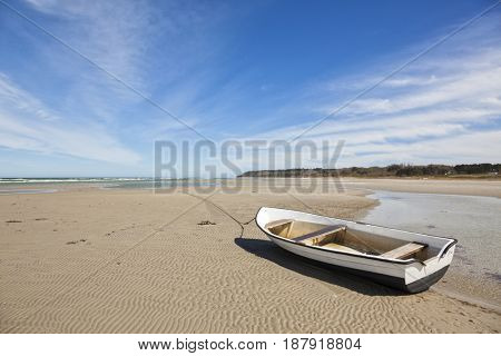 Small boat on the beach of Bonnerup at ebb tide