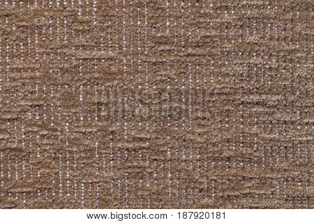 Dark brown fluffy background of soft fleecy cloth. Texture of bronze plush furry textile closeup.