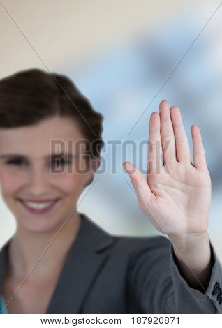 Digital composite of Smiling businesswoman showing stop gesture