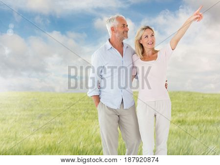 Digital composite of Couple walking in meadow nature
