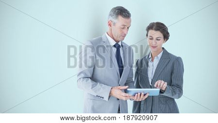 Digital composite of Business people using digital tablet over gray background