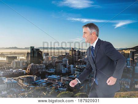 Digital composite of Walking businessman over city