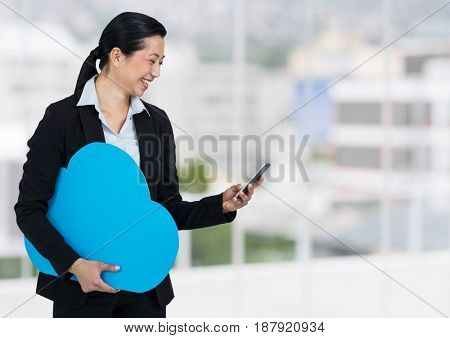 Digital composite of woman holding phone and cloud in office