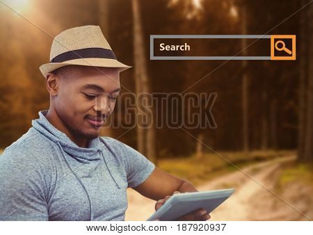 Digital composite of Search Bar with man on tablet in woods