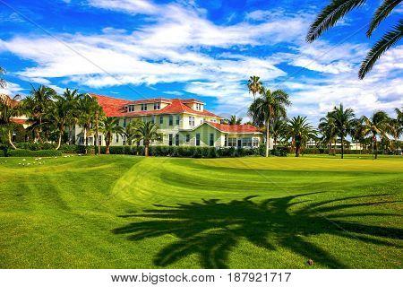 Gasparilla Island, FL, USA - 05/15/2016: From the main road,  the golf course of the Gasparilla Inn & Club Boca Grande on Gasparilla Island Florida