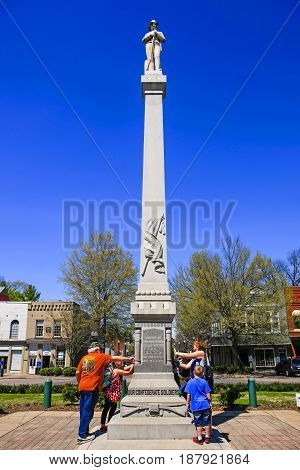 Franklin, TN, USA - 04/04/2016: People around the Confederate monument on the Square in downtown Franklin Tennessee some 21 miles from Nashville