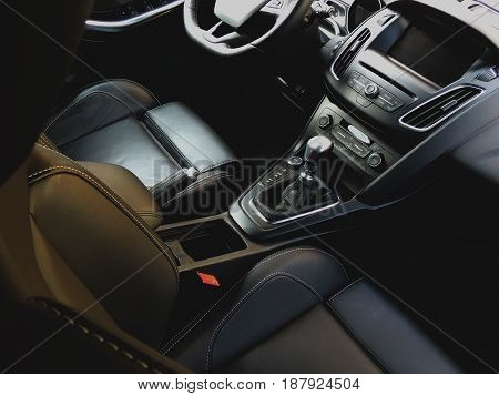 Sport vehicle interior with leather upholstery and sport seats