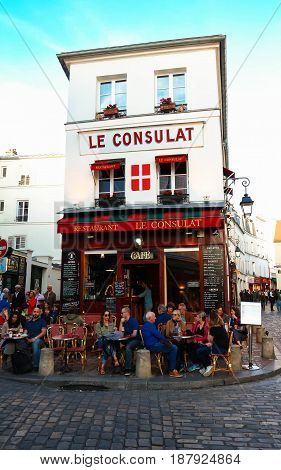 PARIS , France- May 21, 2017: View of typical paris cafe in Paris. Montmartre area is among most popular destinations in Paris, Le Consulat is a typical cafe.