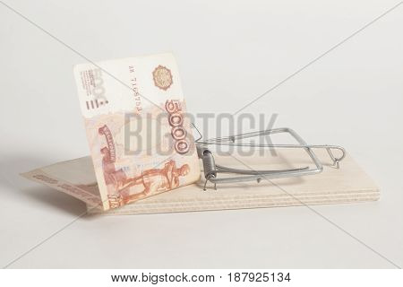Mousetrap with Russian five thousand ruble banknotes on white background