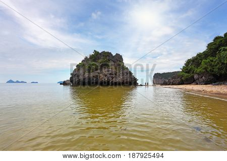 Shallow sandy beach. Picturesque bay in the Gulf of Thailand is surrounded by islands - rocks of various forms. Foggy morning after a heavy storm