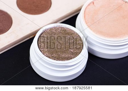 Eye shadow palette in natural colours and makeup brushes, art