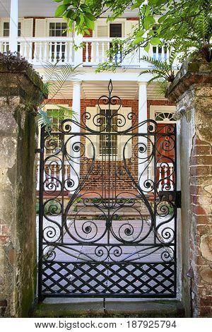 Charleston, SC, USA - 09/09/2016: George Eveleigh House gatesway in the French Quarter of Charleston SC